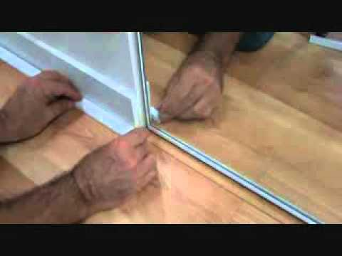 How to lay a laminate wood floor: installing trim near a closet door