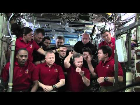 Shuttle, Station Crews Hold Joint News Conference