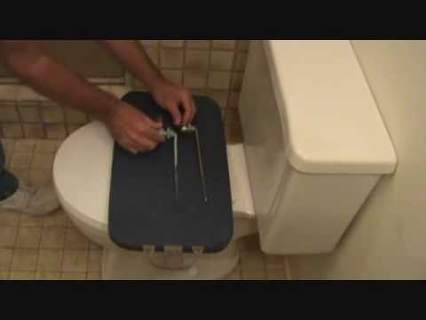 How to replace a toilet handle: Removing the toilet handle