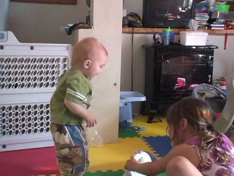 cute baby vacuuming, gets tired and signs for milk