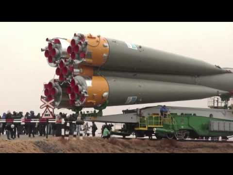 Expedition 27 Crew Prepares for Launch as their Soyuz Rocket Move to Launch Pad
