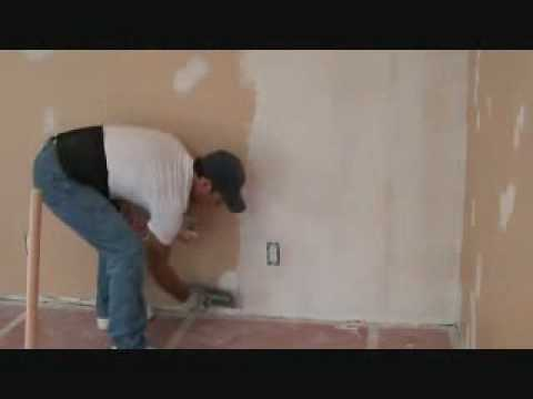 Installing skim coat drywall joint compound material: with a concrete trowel?