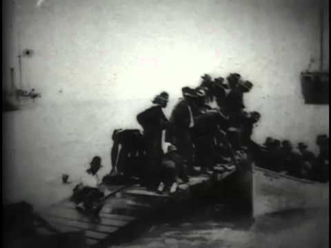 Wounded soldiers embarking in row boats