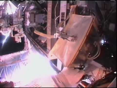 Astronauts Complete Mission's First Spacewalk