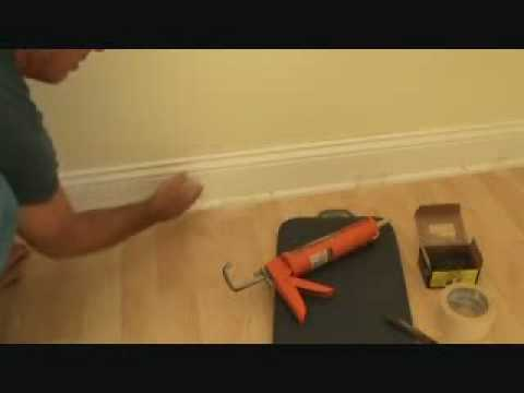 Installing baseboard trim to a concrete wall