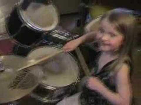 Daughter plays a rock beat