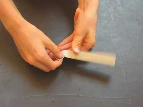 How to fold an origami hockey stick designed by Michael Anton