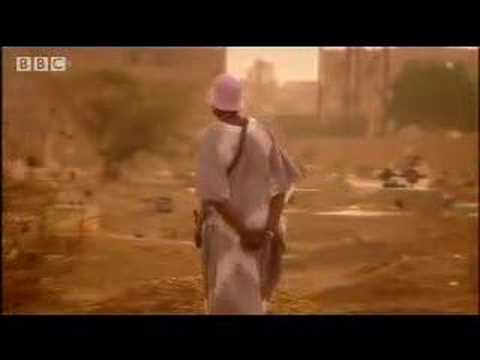 Searching for her father's grave - Alek Wek in Sudan -BBC