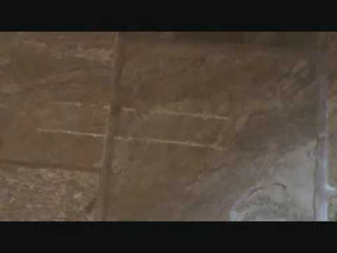 """Repairing """"scratches"""" on a natural stone tile floor"""