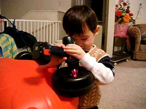 Kid Uses Toy Drill To Fix Toy Car