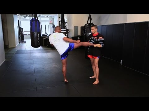 How to Do a Roundhouse Kick | Muay Thai Kickboxing | MMA