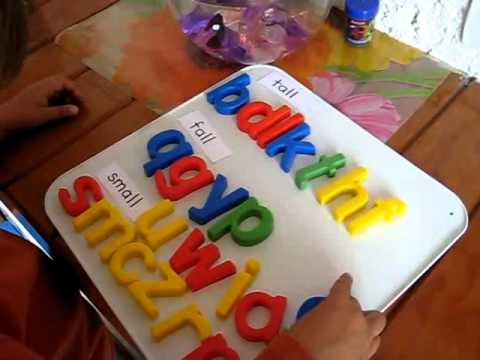 Preschool - Prewriting. Magnetic color alphabet letters categorizing into tall, fall and small.