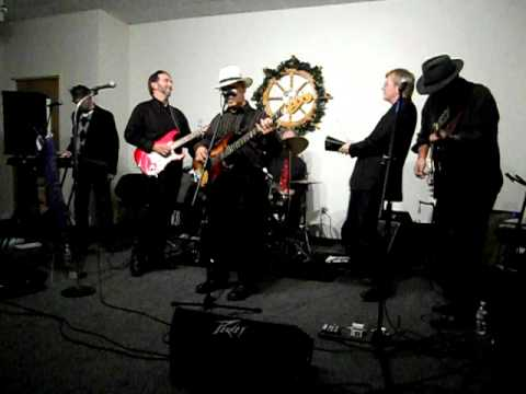 Rick Steves at Company Christmas Party Playing Cowbell