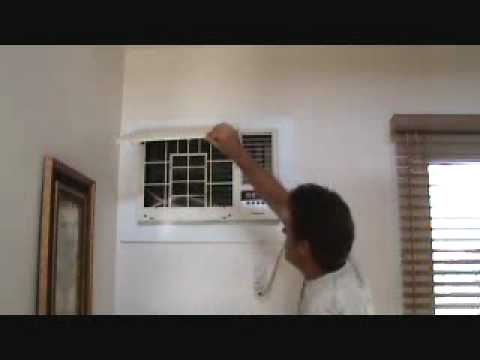Cleaning a wall mounted air conditioning unit