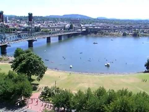 Marching to inner tube float across the Willamette River, Portland Oregon USA