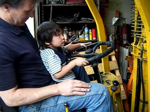 Kid Drives Fork Lift and Lifts Brother In Air