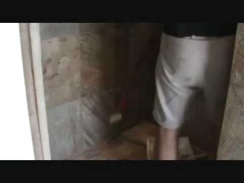 "How to seal a natural stone tile shower: sealing the walls with a ""roller"""