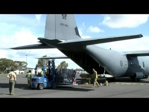 Operation QLD FLOOD ASSIST: Air Force personnel load a C-130 Hercules aircraft