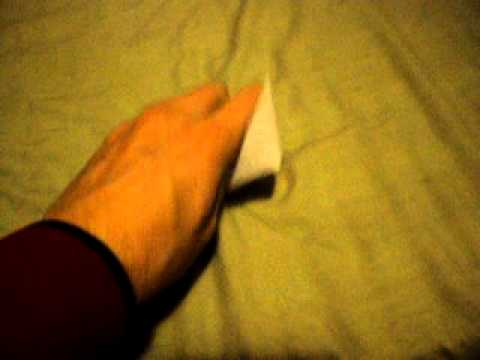 How to scrunch paper into a ball with left hand - How To Do Anything TV video