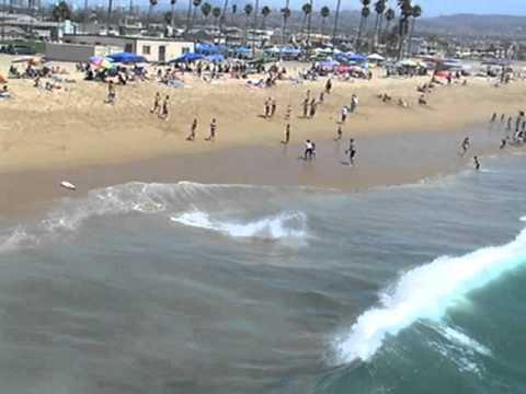 Surfers at Newport Beach, California