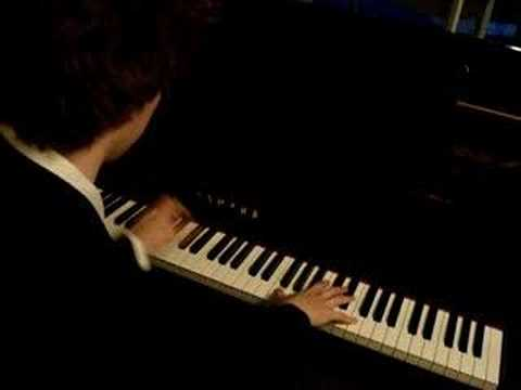 Pianist playing Pas De Deux on Grand Piano