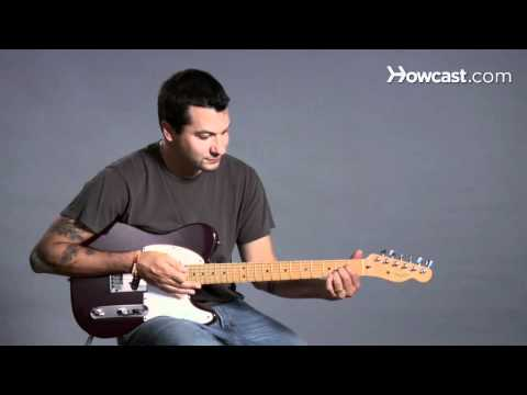 How to Play Guitar: Beginners / Barre Chords: G Minor