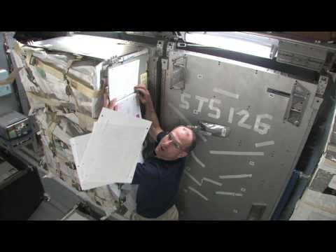 Zero-g paperwork on ISS, HD