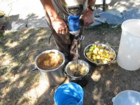 Pear grinding in smaller pot.   Wear an apron! or use a cowl to stop splashes