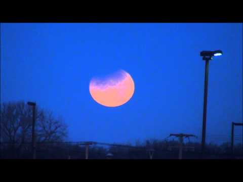 Lunar Eclipse Setting Time Lapse HD Video - Partial Moon Turning Red
