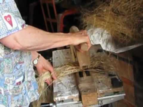 Barb processes a bundle of flax   to to make some lovely flaxen hair!