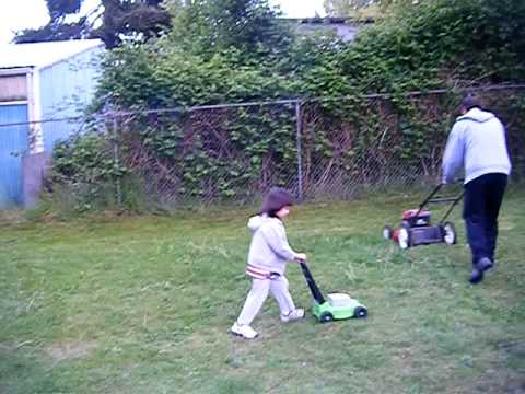 4 Year Old Follows Dad While Mowing With Toy Mower.