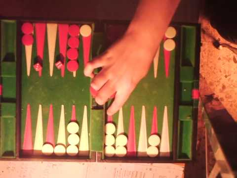 Playing Backgammon - Who is going to win? - ESL British English Pronunciation