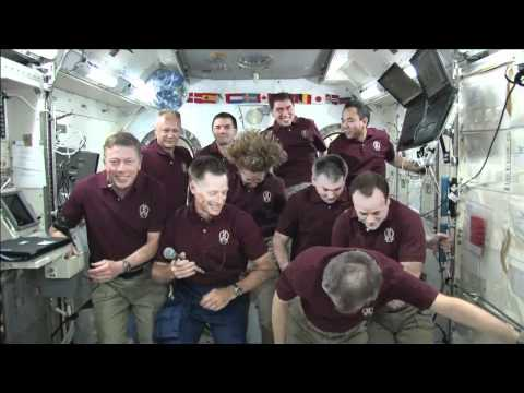 Shuttle, Station Crews in Joint News Conference