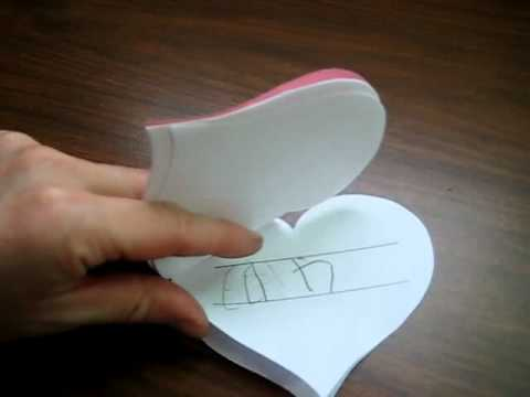 Valentine: pink heart-shaped book for spelling and writing practice.