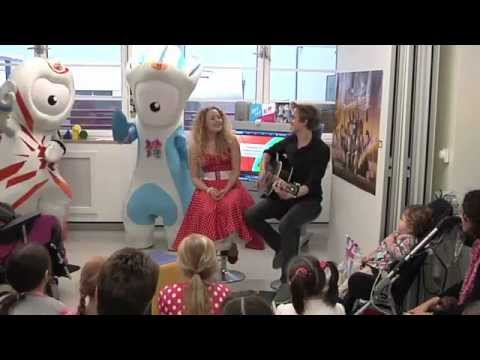 Tom from McFly and Carrie Fletcher sing the London 2012 mascots song