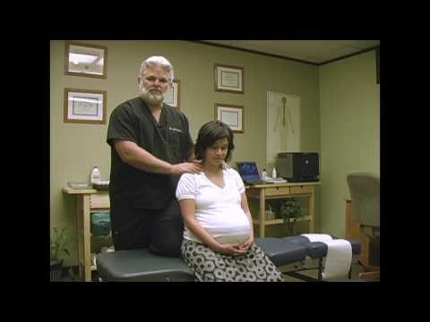 Pregnant Woman Chiropractic Adjustment Demonstration by Austin Chiropractor Care
