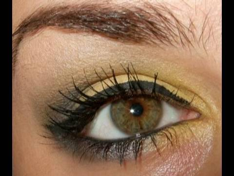 Yellow and grey black smokey eye make up