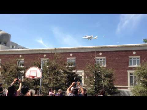 Shuttle Endeavour flies over Ted Alexander Jr. Science Center School