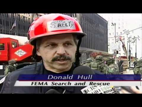 Search and Rescue Teams Sift Through Rubble at Ground Zero (9/18/01)