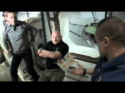 Shuttle Crew Welcomed Aboard Space Station